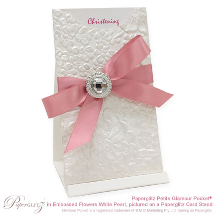Example of a Petite Glamour Pocket in Embossed Flowers White Pearl, embellished as a Christening Invitation.